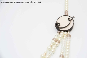 Jewellery, Necklace, Crystals, Pearls, Scrollwork, Victorian. Gothic, Kathryn Partington, Milly Winter, Gareth Partington, Photography, Jewellery Photography, Black jewellery, Statement Jewellery, Cream silk